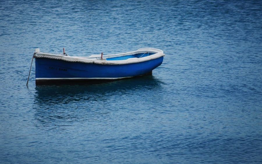 Maltese boat Boat Water Nautical Vessel Waterfront Transportation Mode Of Transportation No People Day Nature Blue Rippled Tranquility Sea Outdoors Moored Beauty In Nature Tranquil Scene Reflection Rowboat Anchored Inflatable