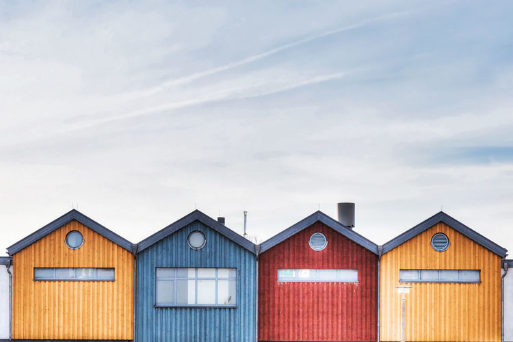 Postcard Red Architecture Beach Hut Blue Brown Building Building Exterior Built Structure Cabin Cloud - Sky Coast Day House Hut Multi Colored No People Outdoors Protection Security Side By Side Sky Skyscraper Wood - Material Yellow