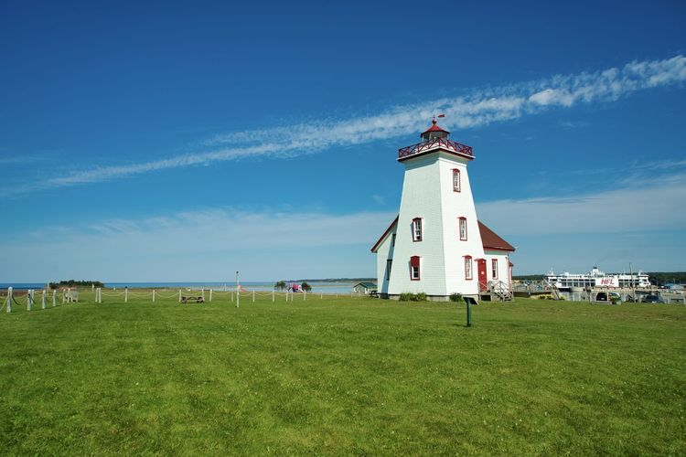 Canada, PE: Wood Island park and lighthouse Cloud Daytime Green Horizontal Architecture Blue Building Building Exterior Built Structure Day Daylight Grass Green Color Guidance Land Lighthouse Nature No One No People Nobody Outdoors Plant Prince Edward Island Protection Safety Scenics Security Sky Tower Travel Destinations Wood Island