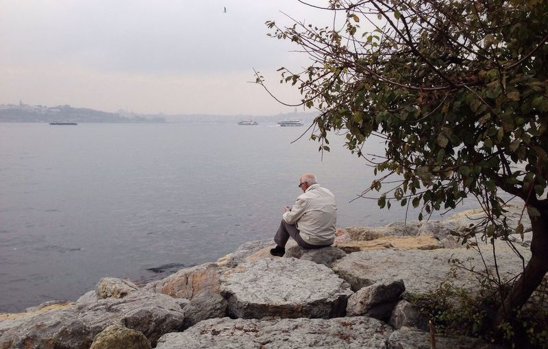 Sitting Rock - Object One Person Nature Full Length Men Water Beauty In Nature Real People Sea Relaxation Lifestyles Day One Man Only Adult Sky People Adults Only
