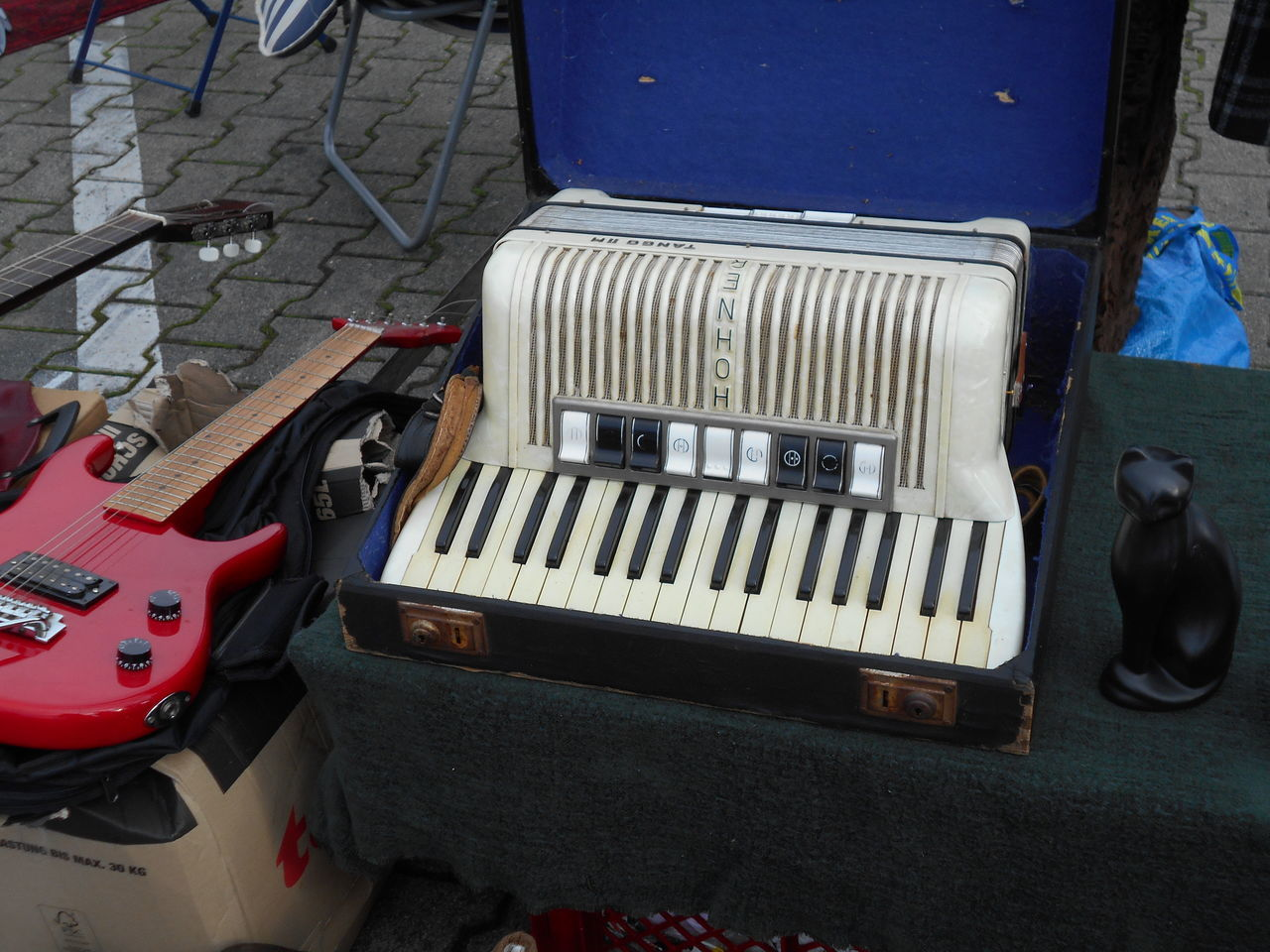 high angle view, accordion, music, old-fashioned, land vehicle, musical instrument, no people, transportation, day, outdoors