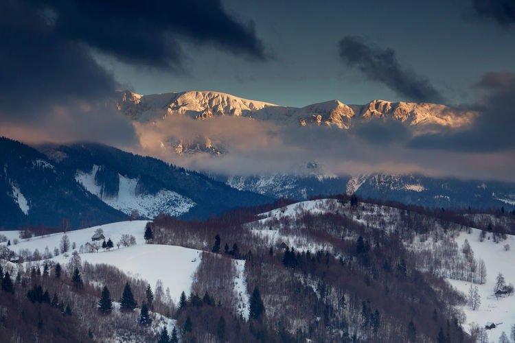 Panoramic view of mountains against sky during winter