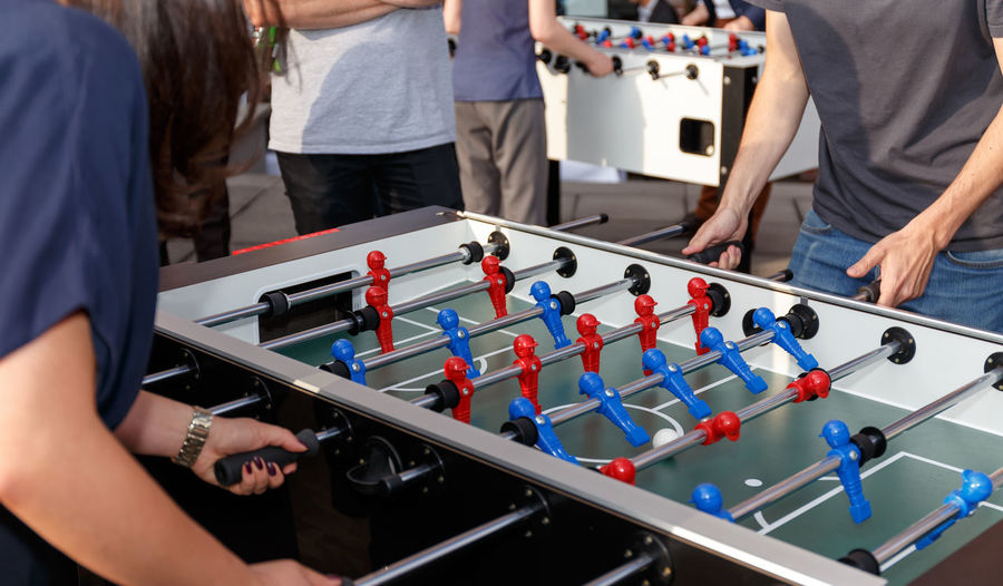Competitors playing foosball during competition