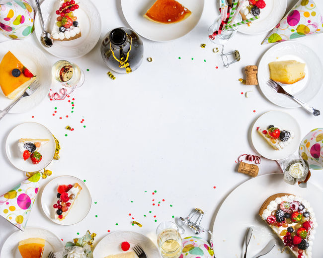Directly Above Table Food And Drink Food Still Life Indoors  High Angle View No People Eating Utensil Large Group Of Objects Freshness Plate Sweet Food Celebration Kitchen Utensil Multi Colored Drink Sweet Temptation Crockery Breakfast Party Backgrounds Space Concept