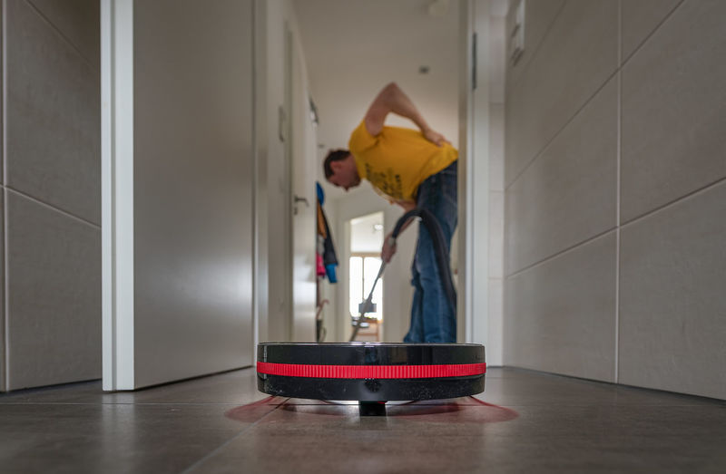 Man working on floor at home