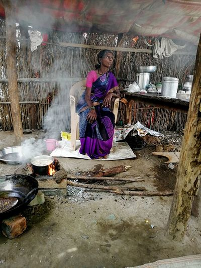 Tribal life, Village life, poor women, Tribal Village Tribal Life Tribal Women Poor Women Dry Leafs And Trees Cooking Poor Women Cooking Hut Poor Life Poor People  Poverty Hurts Full Length Women Sitting