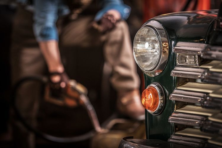 Classic Cars Hobby. Men and His Collectible Vehicle. Retro Transportation Theme. Retro Classic Car Collectible Hobby Transport Transportation Collection Drive Ride Vehicle Automobile Automotive Headlamp Men Driver Gasoline Refill Horizontal Mode Of Transportation Land Vehicle Motor Vehicle