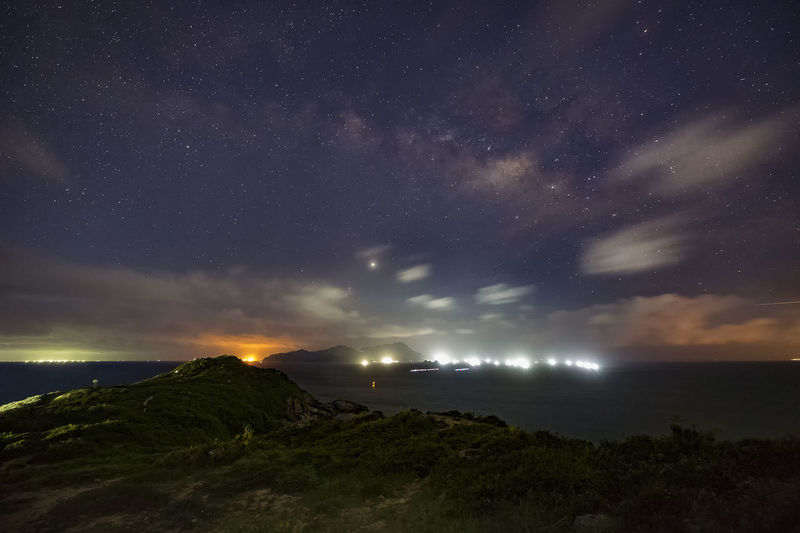 Scenic view of illuminated star field against sky at night