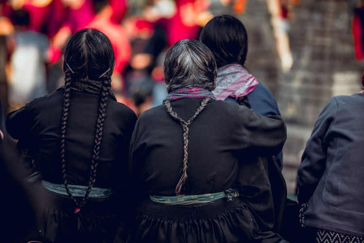 Rear view of females with braided hair