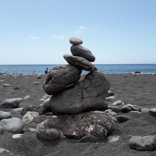 EyeEm Selects Water Sea Beach Sand Pebble Summer Stack Sky Horizon Over Water Cloud - Sky Coastline Ocean Calm
