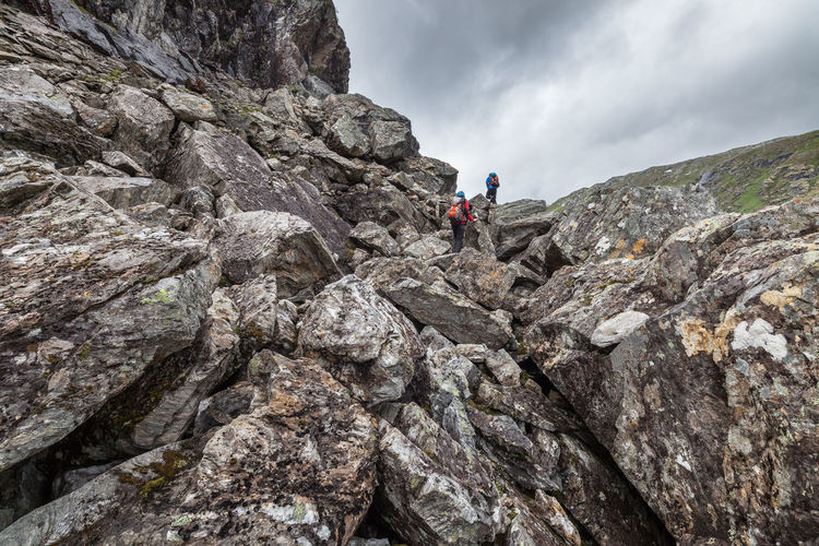 People Hiking On Scree At Jotunheimen National Park