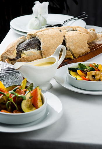 Baked whole sea bass fish in a salt crust served with vegetable salad and sauce Dish Meal Seafood Baked Bowl Close-up Closeup Cooked Delicious Delicious Food Fish Food Healthy Eating No People Nobody Plate Portion Ready-to-eat Restaurant Restaurant Food Salt Crust Serving Size SLICE Table Whole Fish