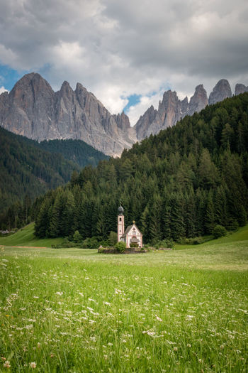 Scenic view of chapel in ranui, santa maddalena, in front of odles group mountains against sky