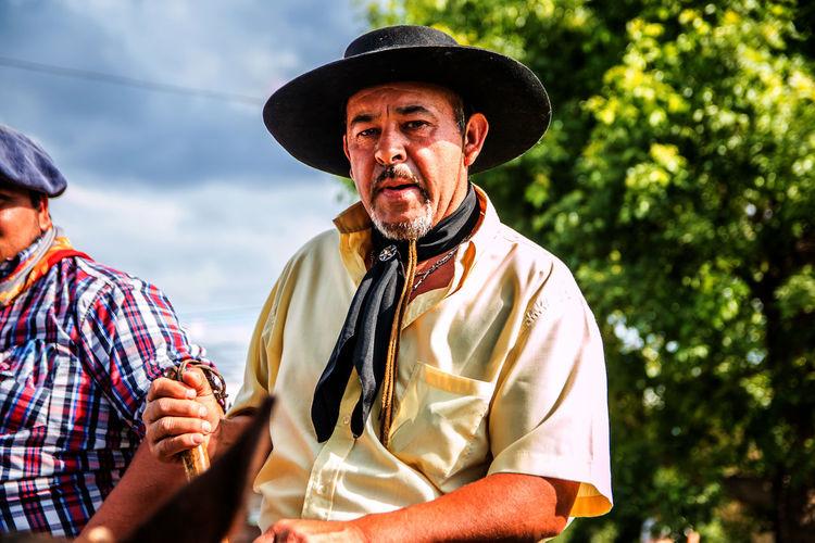 Portrait of man wearing cowboy hat