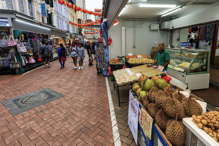 Singapore, Singapore - October 18, 2018: Food stall selling tropical fruits such as Durian in China Town Singapore Marina Bay Sands Merlion Haji Lane, Singapore Arab Street Cityscape Modern Art Museum Buddah Tooth Relic Temple Kampong Glam