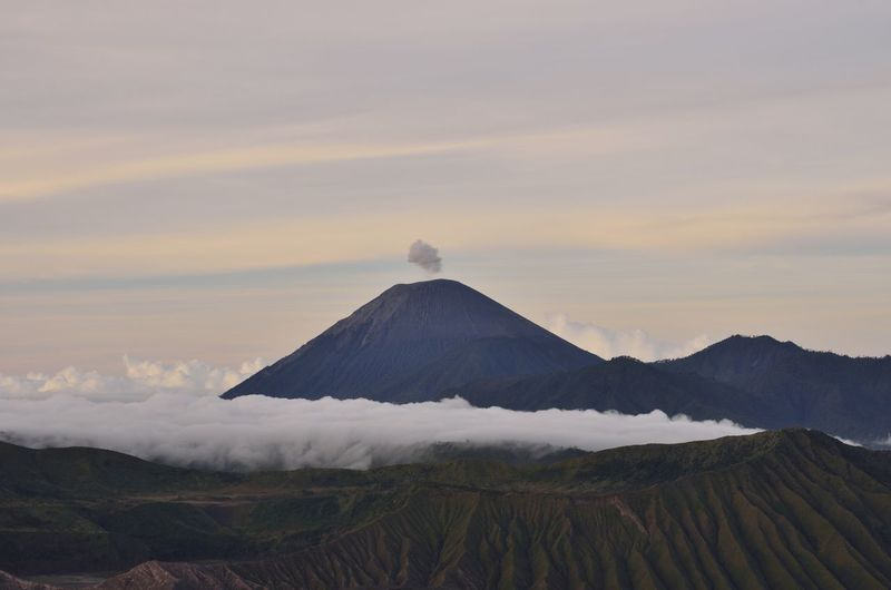 The scene of mount Bromo, East Java. Mountain Volcano Scenics - Nature Sky Beauty In Nature Tranquil Scene Cloud - Sky Tranquility Non-urban Scene Land Landscape Geology Environment No People Idyllic Nature Travel Destinations Smoke - Physical Structure Physical Geography Travel Outdoors Mountain Peak Volcanic Crater