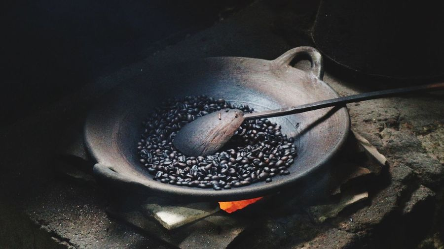 Close-up of coffee beans being roasted in container