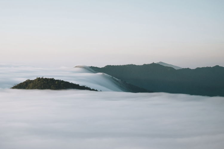 Sea of fog effect on winter mornings. Foggy Morning Tree Snow Winter Cold Temperature Water Sky Landscape Snowcapped Mountain Mountain Range Mountain Mountain Peak Mountain Ridge Mountain Road Deep Snow Calm