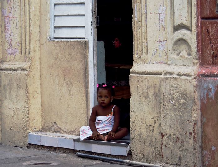 Child Childhood One Person Architecture Real People Girls Sitting Built Structure Lifestyles Day Females Leisure Activity Women Building Exterior Innocence Building Portrait Outdoors Still Life Street Photography The Art Of Street Photography
