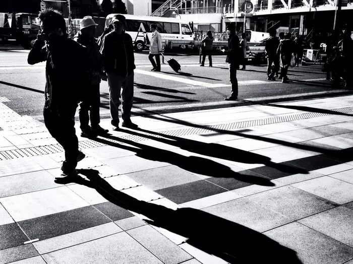 Shadow of people on street