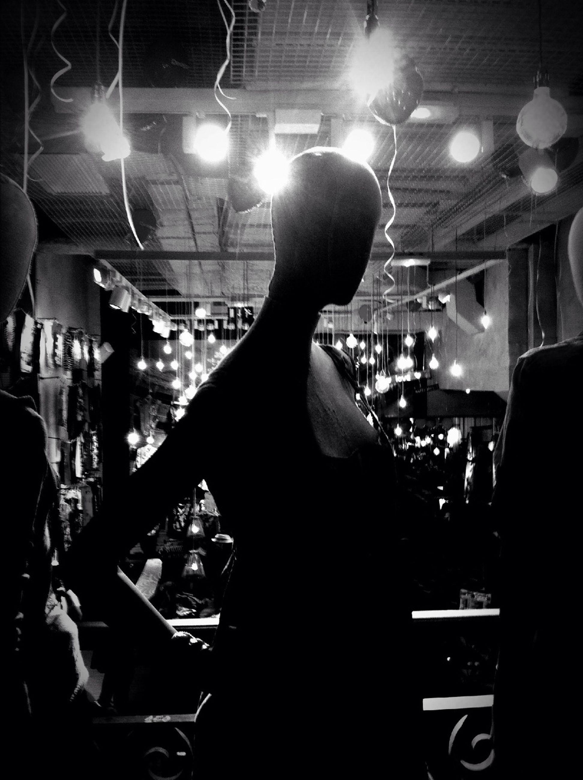 illuminated, indoors, night, lifestyles, men, lighting equipment, leisure activity, nightlife, music, person, arts culture and entertainment, light - natural phenomenon, performance, rear view, standing, light, nightclub