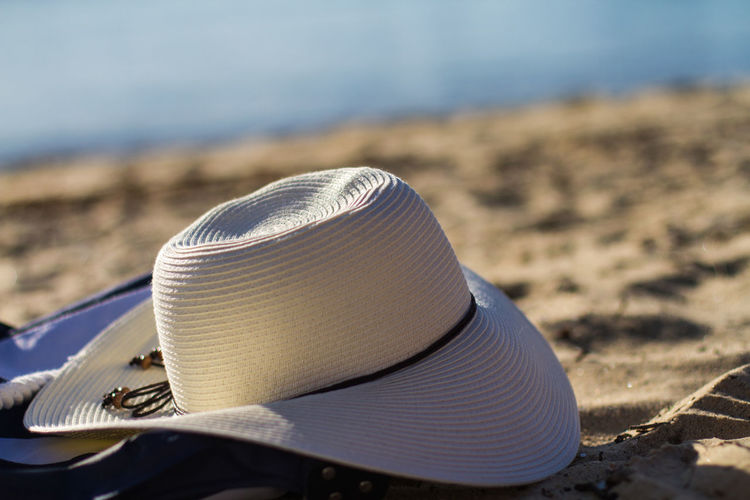 Close-up of hat on sand