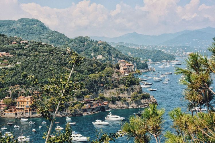 A typical holiday scene. Rich & Famous Wealth Getaway  Vacations Holiday Italy EyeEm Selects Tree Water Mountain Scenics - Nature Beauty In Nature Built Structure Nature Tranquil Scene No People Tranquility Mountain Range Outdoors City Architecture