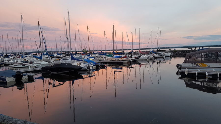 Reflection Water Sunset Pier Landscape Tranquility Harbor Sea Vacations Outdoors Sky Sailboat Day Boat Sunrise Waterfront View