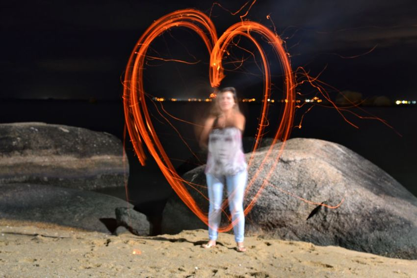Long Exposure Motion Blurred Motion Night Burning Heart Full Length Heat - Temperature Flame Outdoors Real People Skill  Leisure Activity Illuminated Women Standing Lifestyles Sparkler Wire Wool Nature Place Of Heart