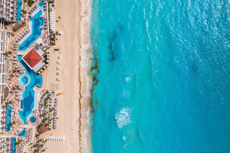 Aerial view of tropical sandy beach with turquoise ocean.