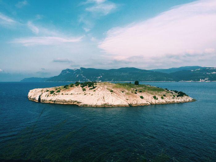 Scenic view of tavsan adasi in sea against sky
