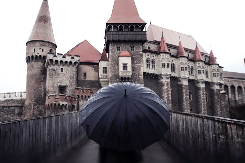 Romania castle Castle View  Romanian Lands Gothic Rain Rainy Days EyeEm Best Shots EyeEmNewHere People Photography People Romania Umbrella Castle Architecture Building Exterior Built Structure History City Day No People Outdoors Close-up