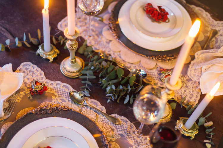 High Angle View Of Candles By Plate On Table