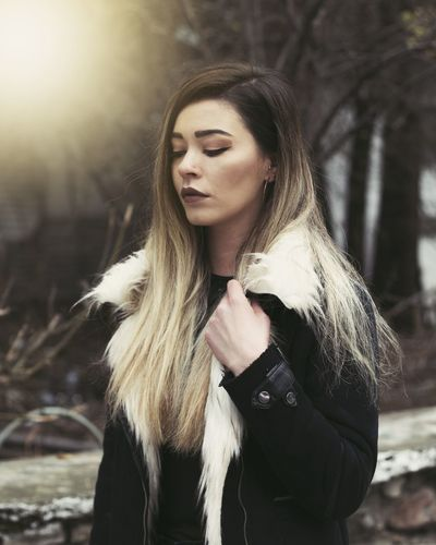 Young woman looking away in winter