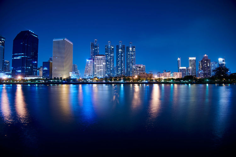 Park Water Building Exterior Architecture Built Structure City Building Office Building Exterior Landscape Skyscraper Illuminated Urban Skyline Sky Waterfront Cityscape Tall - High Night Tower Office Modern No People Outdoors Financial District  Nightlife Long Exposure
