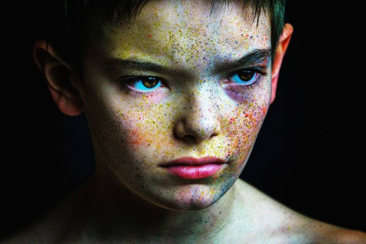 Portrait Of Young Boy With Paint On Face
