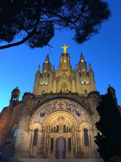 Barcelona Temple Expiatori Del Sagrat Cor Arch Architecture Blue Building Exterior Built Structure Clear Sky Day History Low Angle View No People Outdoors Place Of Worship Religion Sky Spirituality Tibidabo Travel Destinations Tree