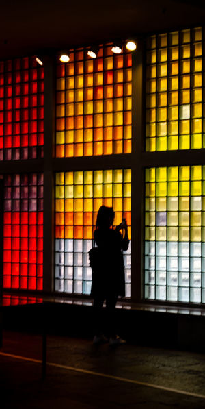Berlin Architecture Building Color Colorful Flooring Full Length Illuminated Indoors  Leisure Activity Lifestyles Museum One Person Orange Color Real People Rear View Silhouette Standing Window Women
