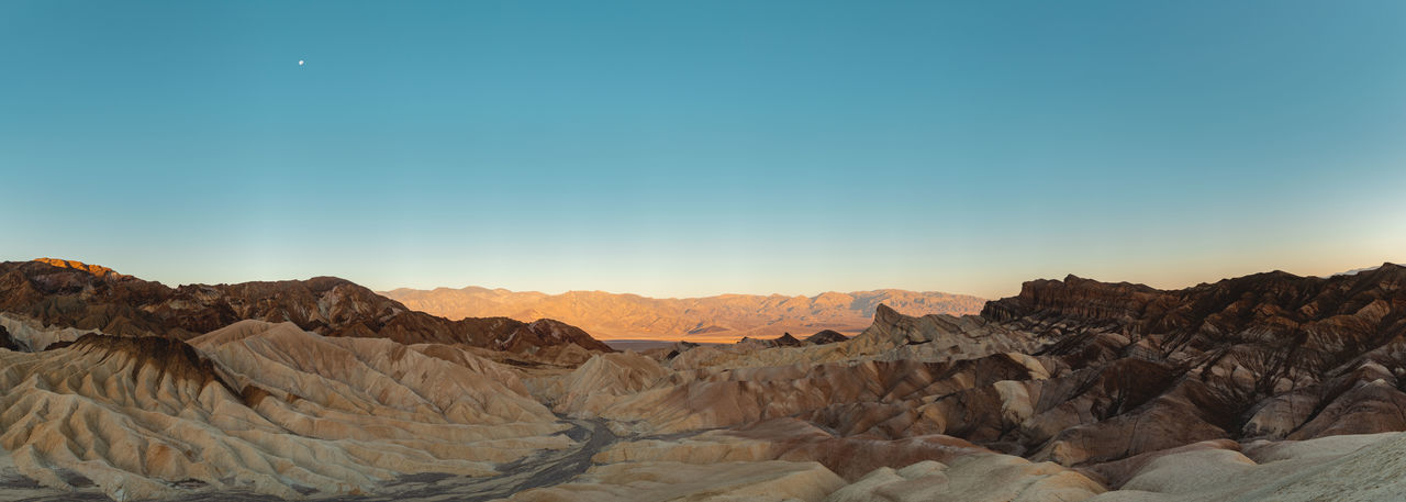After sunrise shot of the eroded landscape at Zabriskie Point, Death Valley, California, USA. Zabriskie Point Death Valley Death Valley National Park Amargosa Range Eroded Landscape Red Cathedral Manly Beacon Eroded Rocks Moon Sunrise Panorama High Resolution Eroded Landscape Sediments Iconic Landscape Texture Soft Colors  Travel Travel Destinations Geology Rock Formation Sky Scenics Desert