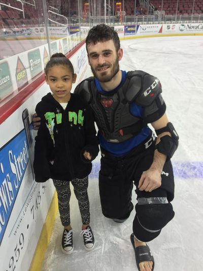 Kinsley with hockey player after the thunder game First Eyeem Photo