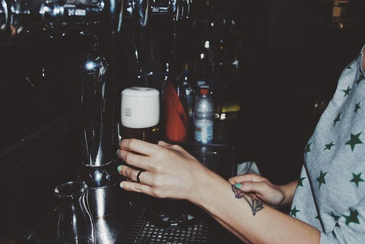 Woman filling a beer glass