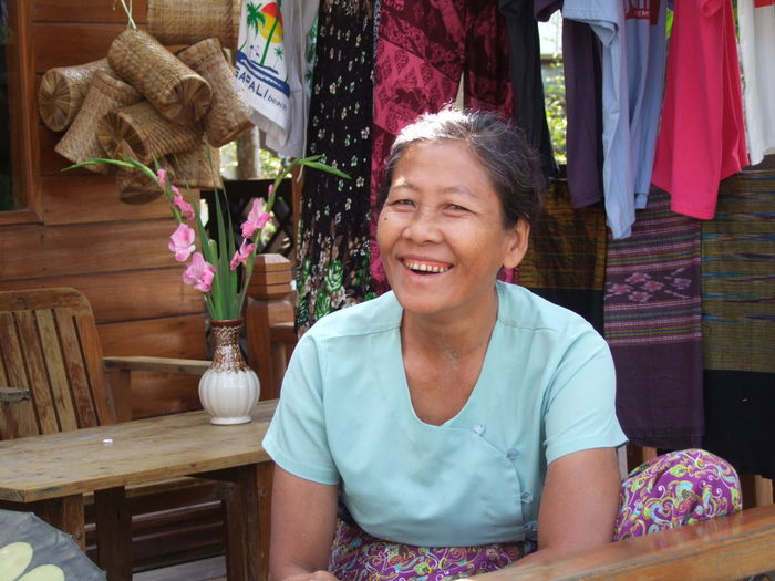 Shop Owner in Ngapali Bay Adult Burma Burmese Woman Front View Happiness Happy Looking At Camera Myanmar Ngapali No Incidental People One Person One Woman Only Portrait Portrait Of A Woman Real Person Senior Adult Sitting Smiling The Portraitist - 2017 EyeEm Awards Waist Up Working Woman