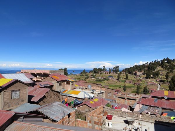 Building Exterior Architecture Built Structure Day No People Outdoors House Roof High Angle View Blue Sky Residential Building Town Nature Tree Travel Destinations Peru Amantani Island Amantaní Lake Titicaca Ancient Civilization This Is Latin America