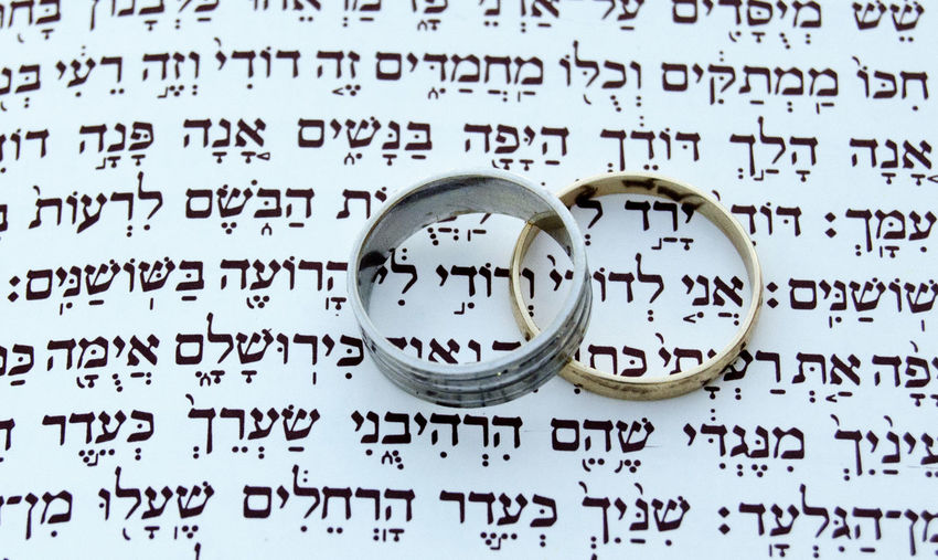 Two wedding rings Text Communication No People Indoors  Number Metal Document Paper Antique Data Wedding Technology Close-up Ring Togetherness Silver Colored The Past Education Global Communications