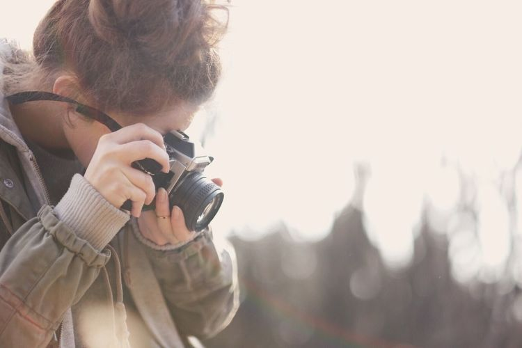 Girl photographing Girl Photography Themes Camera - Photographic Equipment Technology Photographing Holding One Person Activity Photographer Occupation Adult Young Adult Headshot Day Photographic Equipment SLR Camera Portrait Hairstyle