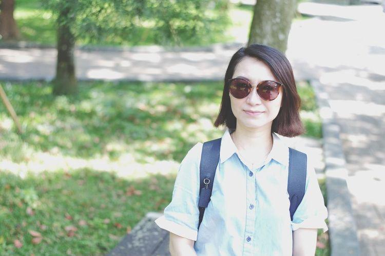 Woman wearing sunglasses at park