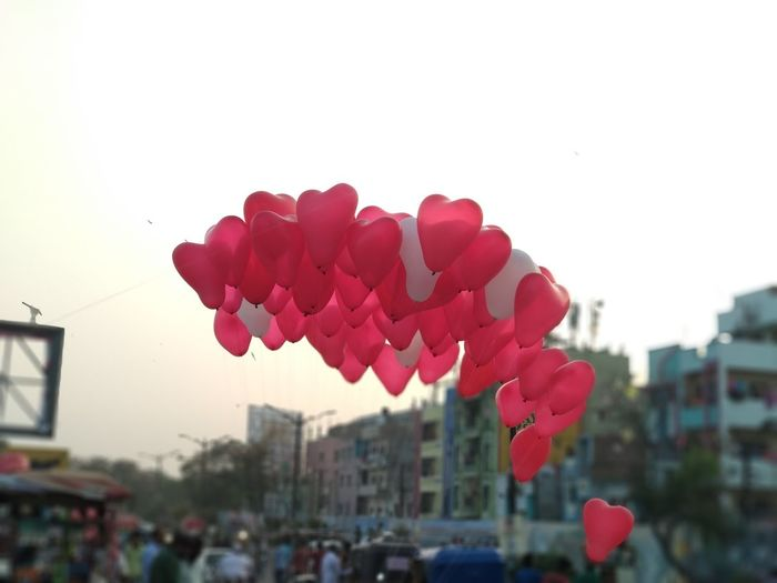 In Sky Red Shape Heart Shape Heart Balloon Red Balloon Red White Heart Red Flower Building Exterior Nature Architecture City Outdoors Sky No People