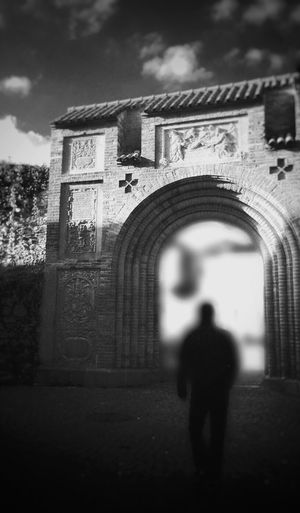 Arch Architecture Built Structure Standing Brick Wall History In Front Of Building Exterior Archway Day The Past Castle Medieval Outdoors Person Arched Historic Walk Into The Light Unknown Future