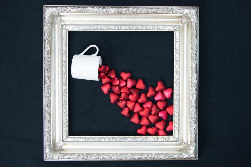 Framed love spill over Love Valentine Valentine's Day  Black Background Frame Heart Hearts Indoors  No People Red Spill Studio Shot