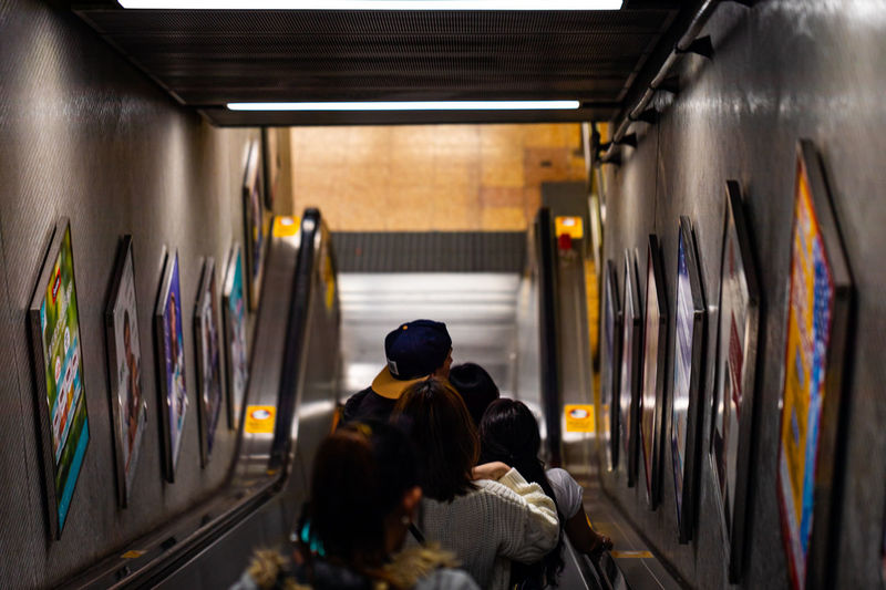 Subway downgoing escalator with people